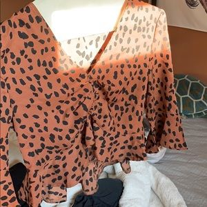 Cinched cheetah print blouse